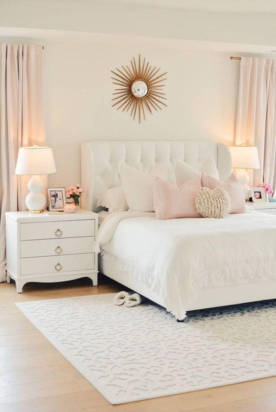 a white upholstered bed with a tufted headboard is nice for a cozy and at the same time luxurious bedroom