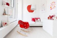 13 This is a kid's bedroom done in white and red, it's bright and fun