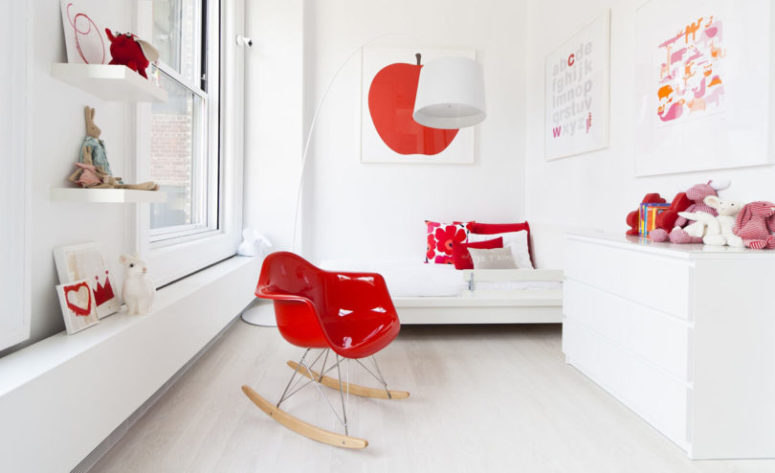This is a kid's bedroom done in white and red, it's bright and fun