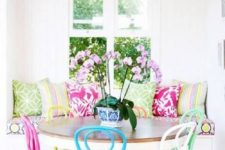 13 a bright dining space with super bright pillows and colorful chairs looks fun, cheerful and colorful