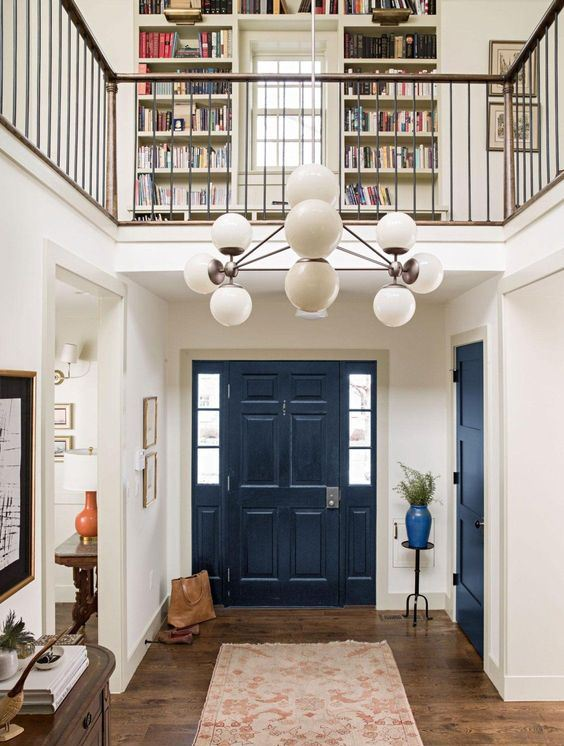 a navy door stands out in a neutral space is a cool idea to make a statement with the trendiest color of the year