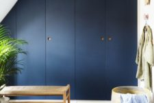 13 an Pax wardrobe done in classic blue, the color of the year, and oak handles