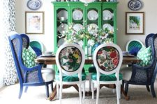 14 colorful printed chairs with emerald seats and bright navy wingback chairs to pair with them