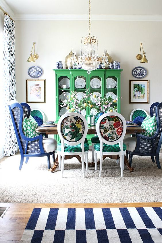 colorful printed chairs with emerald seats and bright navy wingback chairs to pair with them