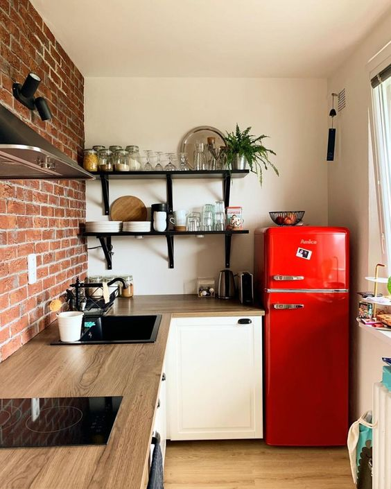 a bright red fridge brings color to the space and makes it fun, bright and welcoming