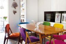 15 a stylish and cozy mid-century modern dining room with matching yet differently upholstered chairs