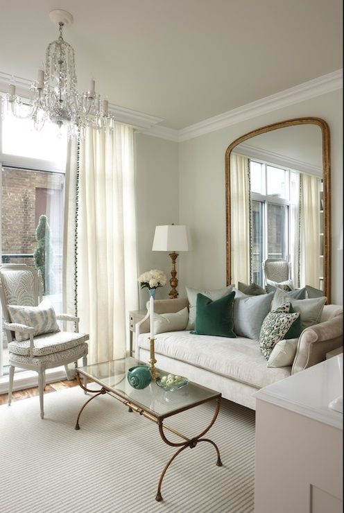 light-colored floor-length curtains match the living room and make it look higher and larger