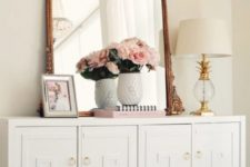 16 an IKEA Malm dresser turned into a chic vintage piece with overlays and brass knobs