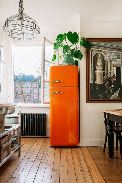 try a bright orange fridge to bring a fun and colorful touch to your kitchen and renovate it at once