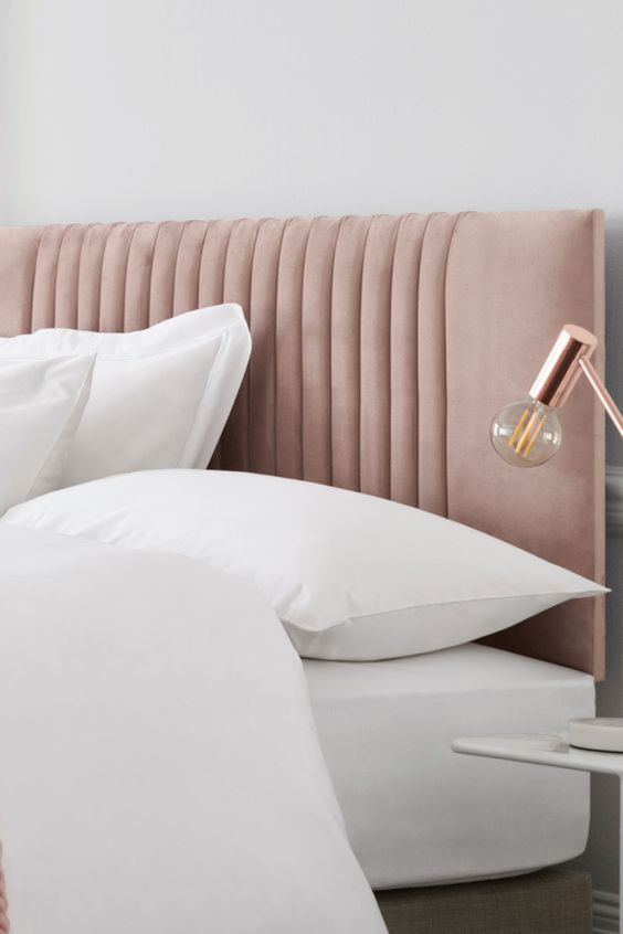 a chic blush upholstered headboard is a subtle and stylish touch of color to your bedroom