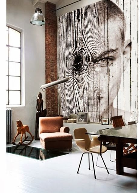 a unique wall art on wood that takes the whole wall is a bold statement