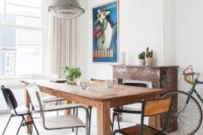18 a chic dining space with a wooden table and mismatching chairs that make it evne more inviting and whimsy