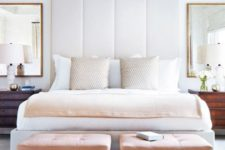 18 a statement white upholstered headboard and little pink stools to create a soft feel in the space