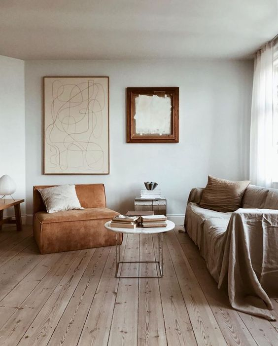 an airy and welcoming earthy tone interior in ocher, rust, neutrals and light-colored wood