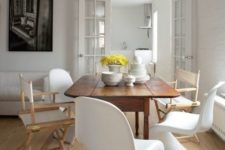 19 a chic dining room with a wooden table and totally mismatching chairs in the same color scheme
