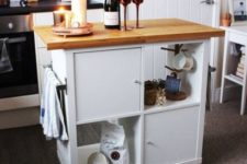 19 an IKEA Kallax turned into a mobile kitchen island with a wooden countertop and some closed compartments
