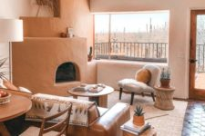 20 a cool and warm living room with an earthy tone hearth and a leather sofa, a rattan table and a stump