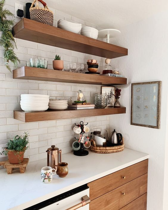thick open shelves match the kitchen cabinets and look statement-like
