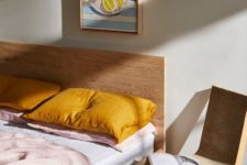 21 a chic bedding set with white, blush and mustard elements to make it bold and make the bed cooler