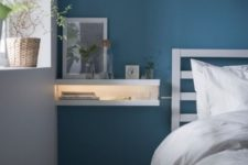 21 a minimalist nightstand made from two MOSSLANDA picture ledges stacked on each other with an LED strip inside