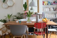 21 a wooden dining table with mismatching chairs in various colors and of various styles