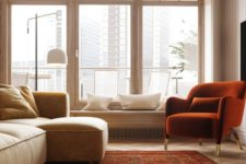 22 a contemporary, light and airy living room with touches of reddish and rust plus light ocher shades