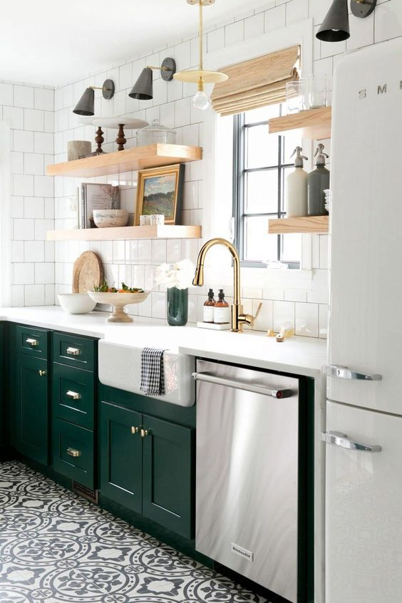 a forest green and white kitchen spruced up with gold touches and thick open shelving and Roman shades