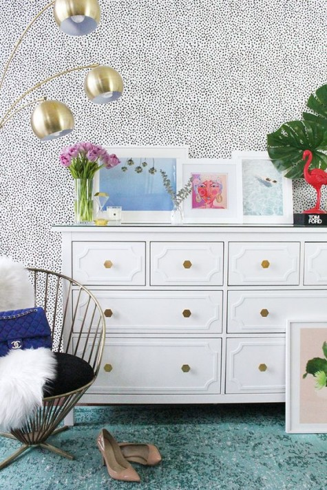 an IKEA Hemnes hack with geometric brass knobs looks very glam