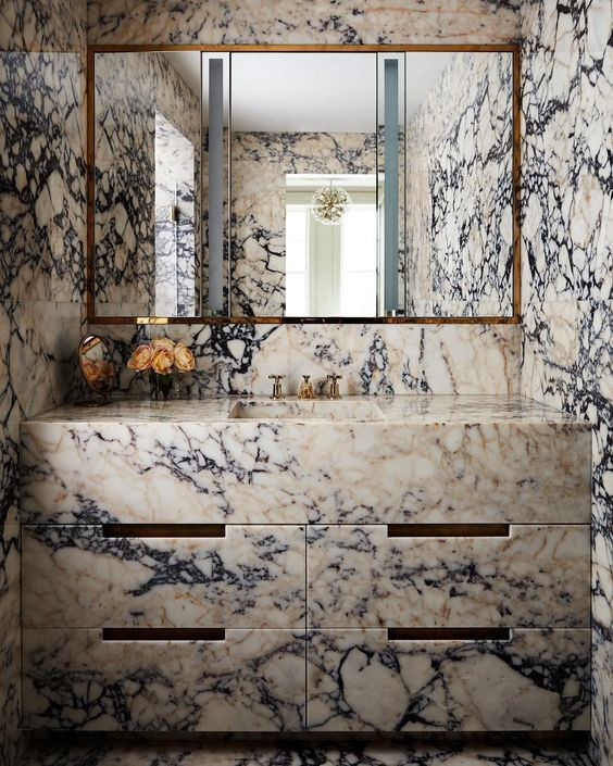 such unique marble on the walls and on the vanity will make your bathroom stand out a lot