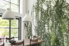 23 tall green plants growing right in the floor make the space cool, fresh and very natural