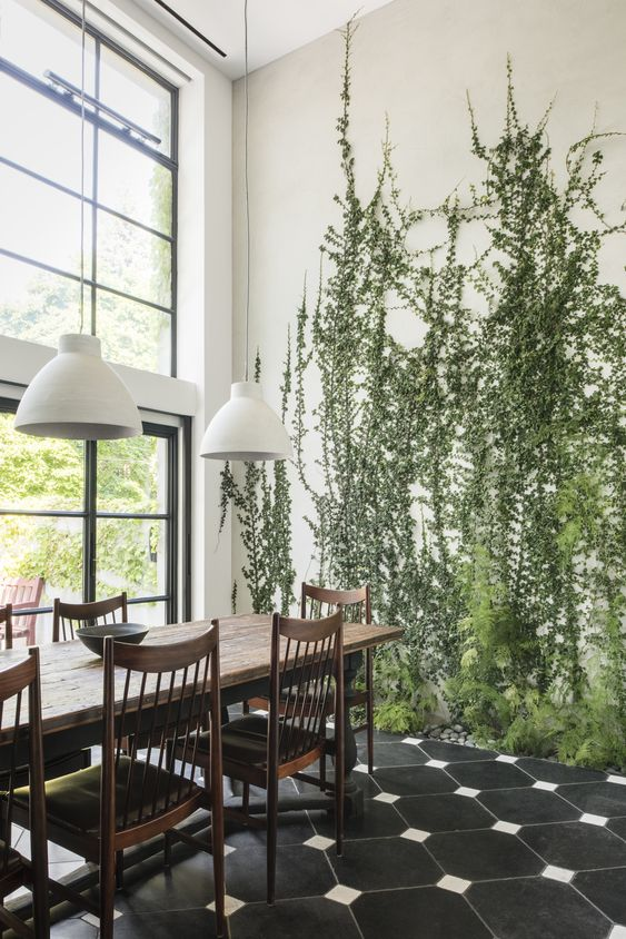 tall green plants growing right in the floor make the space cool, fresh and very natural