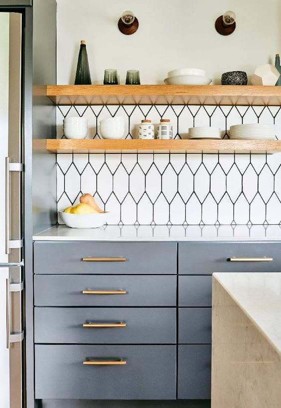 thick light-colored wooden shelving contrasts the graphic tile bakplash and looks cool