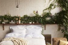 24 a boho bedroom with vines covering the wall over the bed that bring a fresh feel here