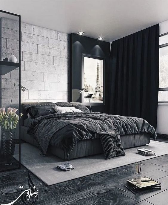 a bold black and white bedroom with dark floors, black curtains and a glass storage unit