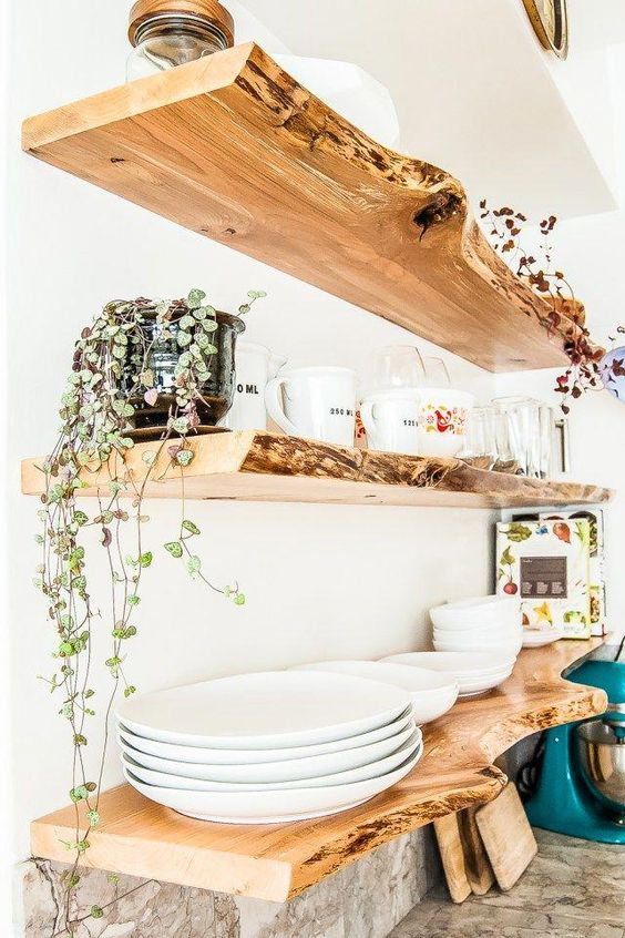 think of live edge open shelving to brign a natural feel to the kitchen, it's a trendy idea