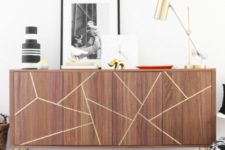 25 a Stockholm sideboard with gold hairpin legs and a geometric design with gold foil tape
