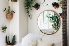 26 potted greenery in baskets attached to the wall over the bed refresh the space and make it bolder