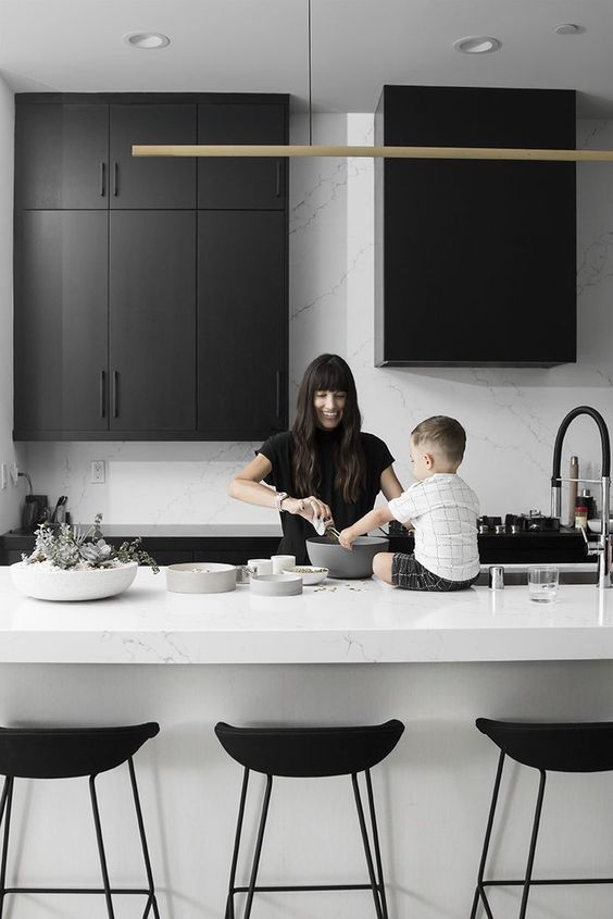 a stylish and bold black and white kitchen with white marble is a very elegant contemporary idea