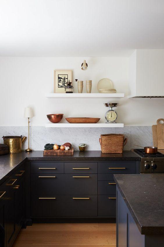 dark blue cabinets paired with black stone countertops and gold touches for a super chic look