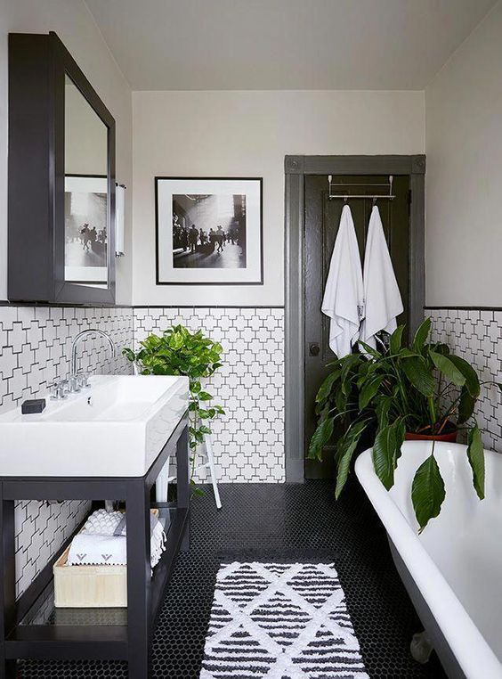 partially tiled walls with black grout that accents the tiles a lot and makes them cooler and bolder
