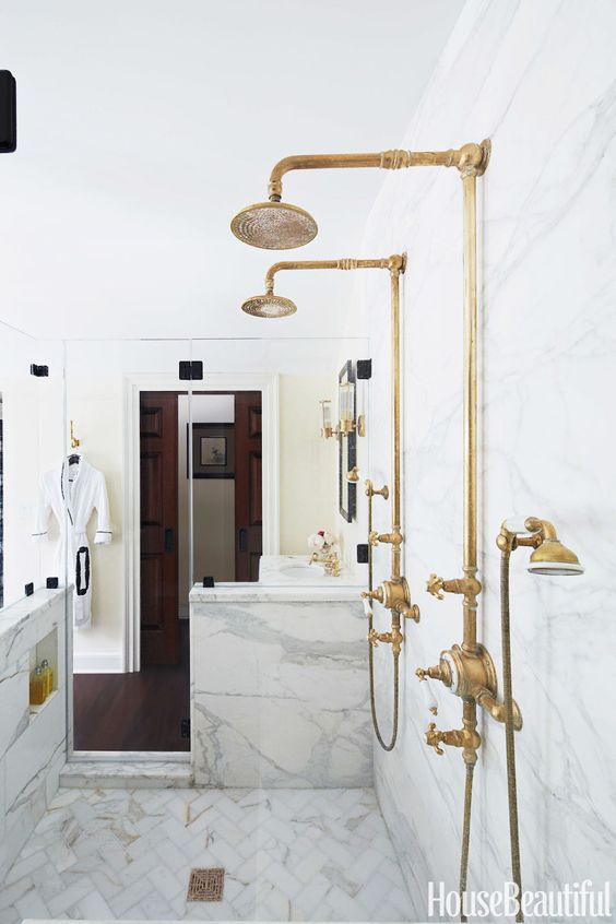 vintage brass fixtures stand out in a neutral bathroom and make it much more refined and chic