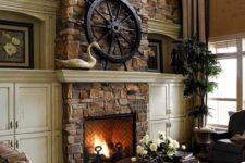 a dark vintage living room with a stone fireplace, checked furniture, potted plants and some elegant accessories
