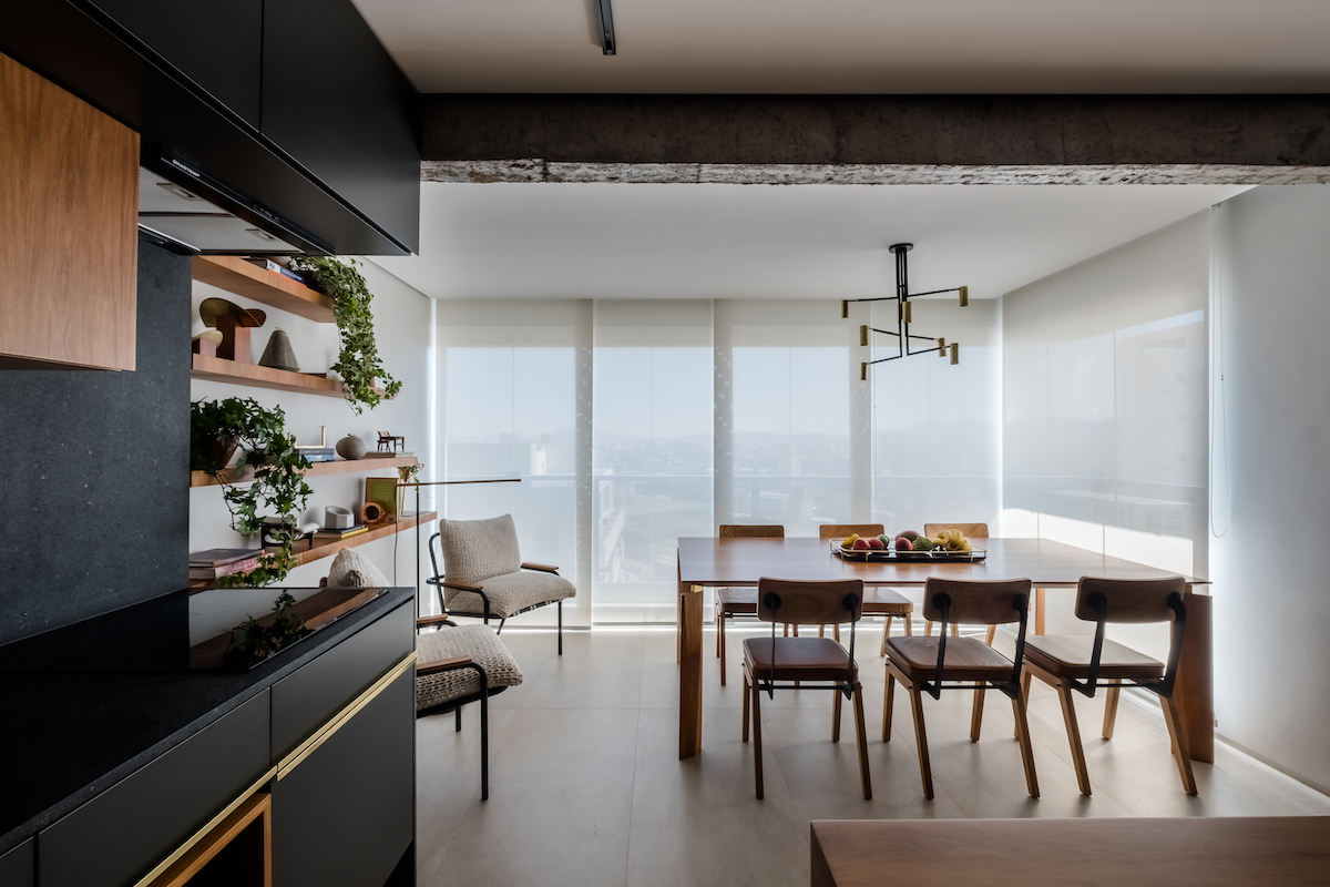 This contemporary and not very large Brazilian apartment is a second home for a family from Israel and it features cool views