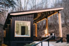 01 This contemporary cabin is built of a shipping container and indoor and outdoor areas are placed under the same roof