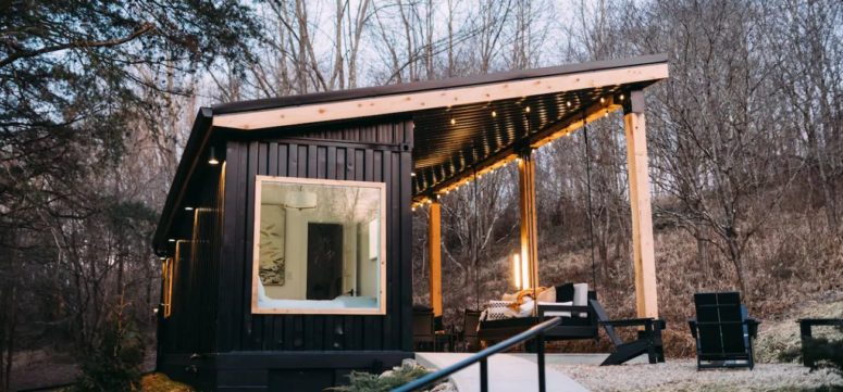 This contemporary cabin is built of a shipping container and indoor and outdoor areas are placed under the same roof