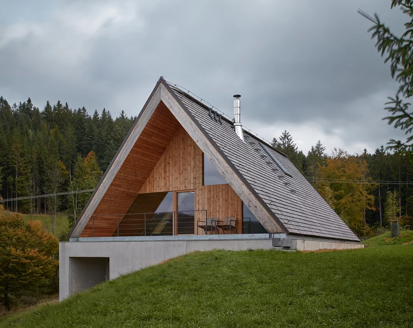 This contemporary weekend house in Beskydy mountains was inspired by traditional cabin retreats and features a creative approach to the landscape