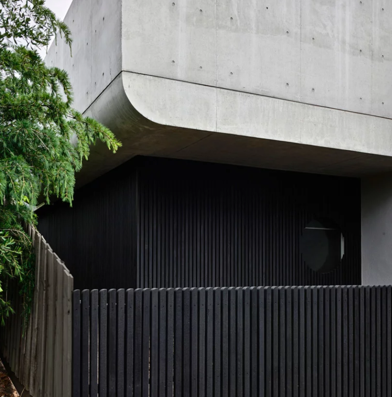 This home is a renovation of a Victorian house done with concret and curved shapes and lines