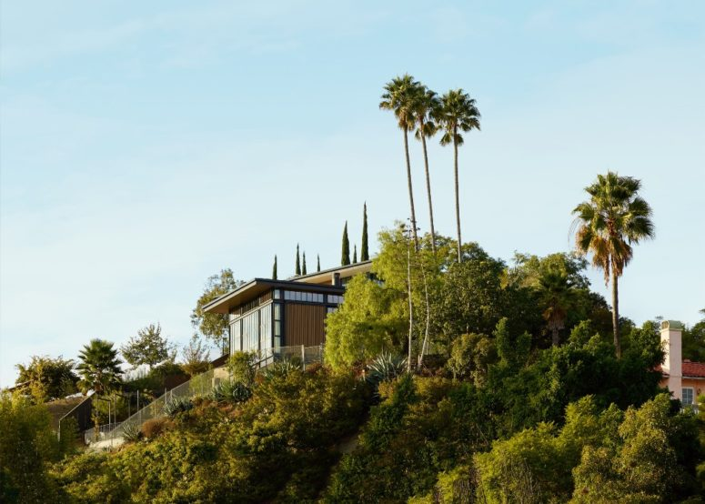The house is built on a steep slope close to LA