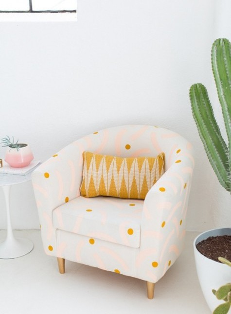an IKEA Tullsta chair renovation with polka dots and bright pink patterns and finished with a printed crochet pillow