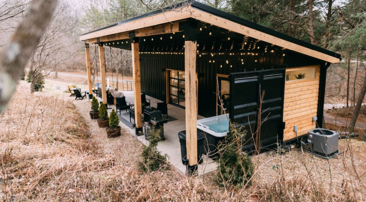 The covered porch houses a hot tub, a swing bed and a cozy sitting area with modern furniture